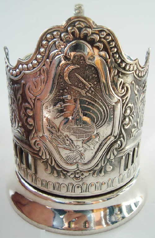 Holder 'Cosmos of USSR'. German silver cup holder with a silver coating. Issue 1963. High carved edge. Depict achievements of the Soviet era