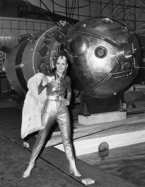 Soviet fashion model Mila Romanovskaya in London at the Soviet exhibition next to the mock of the spacecraft Voskhod. August 1968