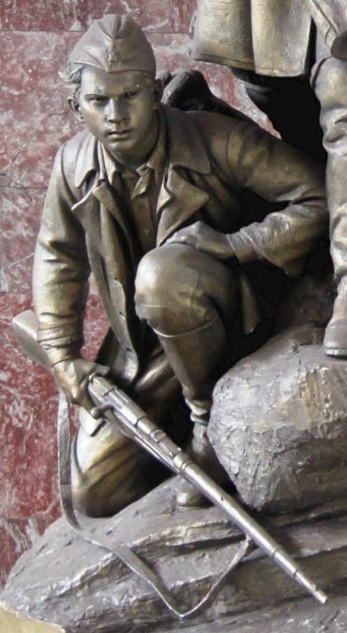 The sculptural group 'partisans' in the lobby of the metro station Partizanskaya, Moscow closeup