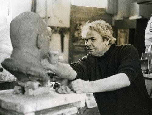 Soviet sculptor Albert Sergeyev working in his studio