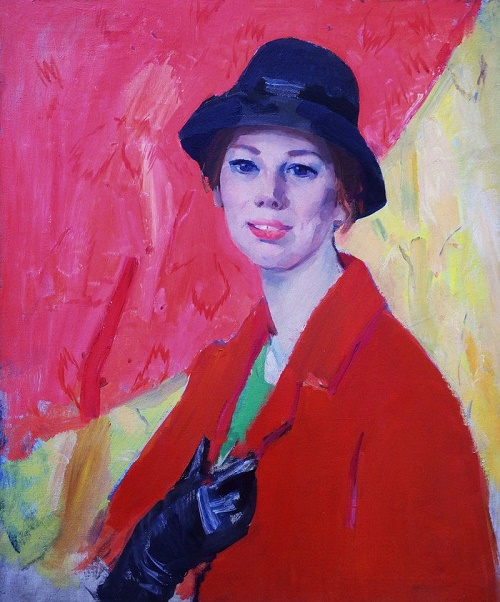 A girl in a red coat. Portrait. 1960s