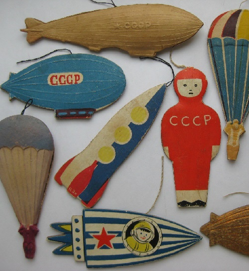 Astronauts ans space rockets. USSR Christmas decoration