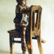 Ilyusha on a chair