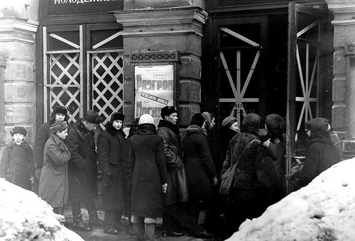 Old photo of Leningrad, the USSR. The taped crosswise windows of homes