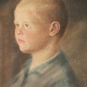 Portrait of a boy behind car glass. 1937, closeup