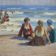 Sitting on the sandy beach three girls