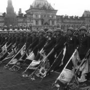 Soviet soldiers stand with the Nazi banners lowered during the Victory Day parade on Red Square in Moscow, June 24, 1945