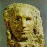 A woman's head. 1909. Stone