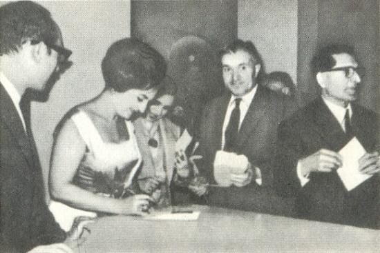 The beautiful Soviet opera singer Zara Dolukhanova giving autographs