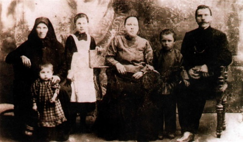 Family of Romadin (right to left) - Father Mikhail, Nikolai Romadin, mother Maria, sisters and grandmother. 1908. Samara