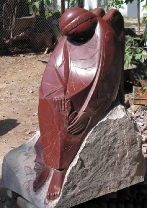 Sad angel. 2004. stone (porphyry)