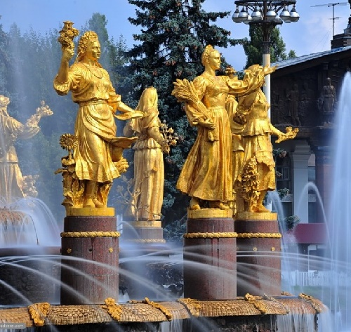Golden sculptures of girls symbolizing republics of the USSR stand in circle as a part of the main Soviet Monumental Fountain 'Golden Sheaf'