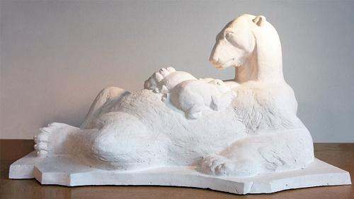 Polar bear feeding cubs