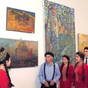 Soviet Turkmen artist Chary Amangeldyev at the exhibition of his paintings