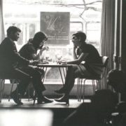 In a cafe. 1970s