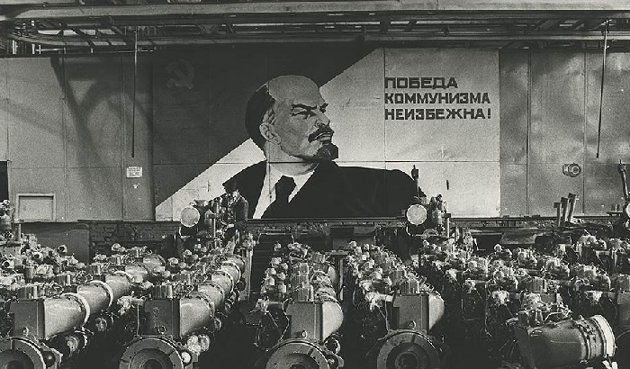 The victory of communism is inevitable. In the shop of the motor plant. 1969