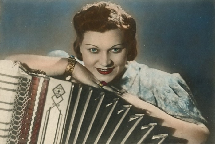 With an accordion. 1950s