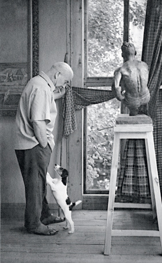 A.A. Deineka with his dog Tyubik in the studio at the artist's dacha. The end of the 1950's - the 1960's