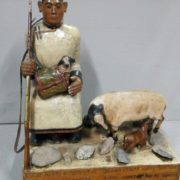 Chaban (shepherd) with a gun with sheep and lambs