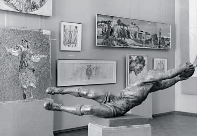 Fragment of the exposition of the personal exhibition of AA. Deineka in 1957 in Moscow with the sculpture 'Goalkeeper'
