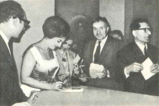 The beautiful Soviet opera singer Zara Dolukhanova giving autographs