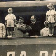 Children on the platform next to Stalin