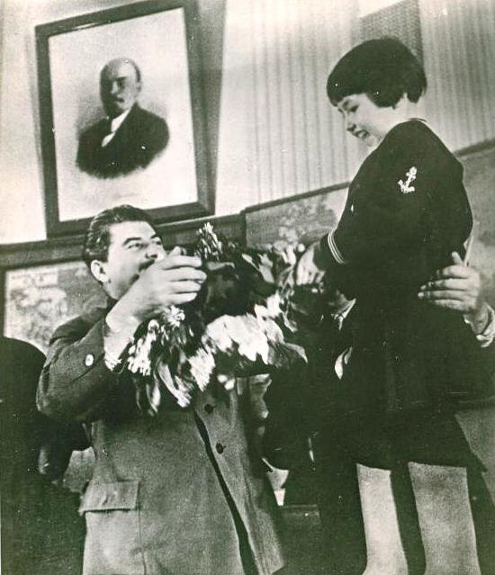 Gelya Markizova giving flowers to Stalin