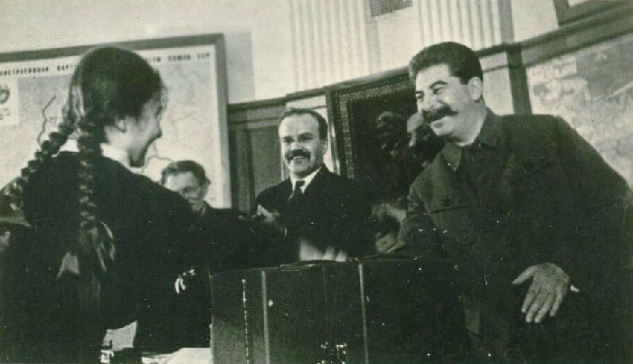 Molotov and Stalin greeting a girl