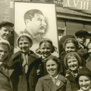Thankful Soviet children with a portrait of Stalin