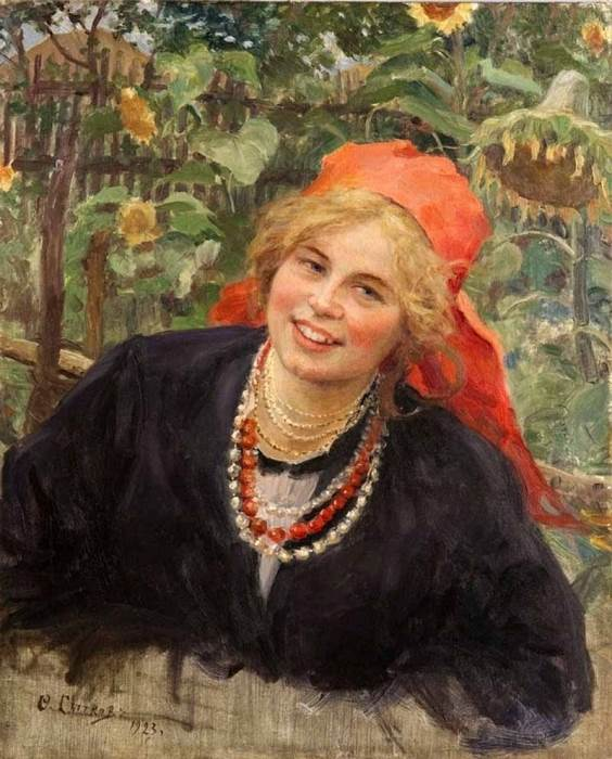 A young woman in a red scarf